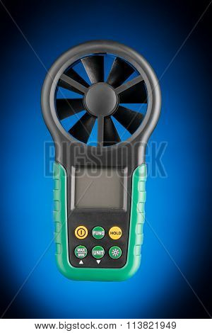 Digital handheld anemometer isolated on blue background