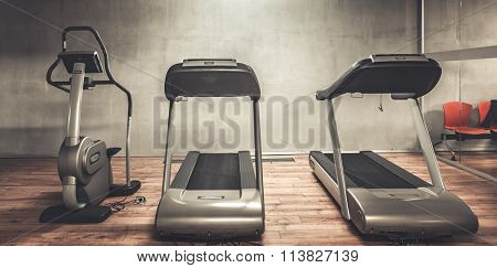 Treadmills exercise machines standing in a row in gym