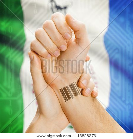 Barcode Id Number On Wrist With Canadian Province Flag On Background - Yukon