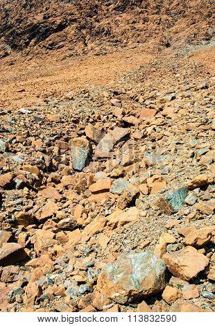 Dry Yellow Broken Rocks On Mountain Slope