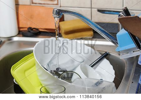 huge heap of dirty dishes
