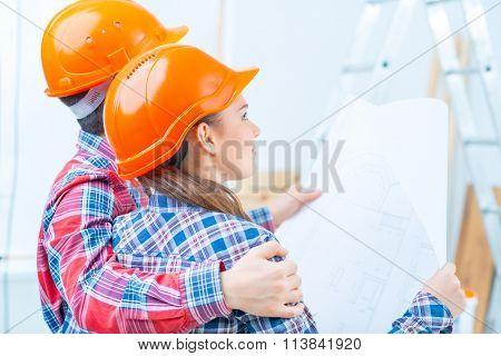 Happy couple doing renovation