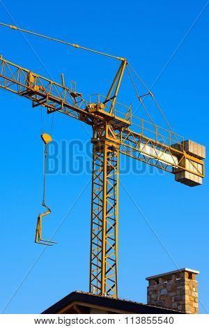 Yellow Crane In Construction Work Site