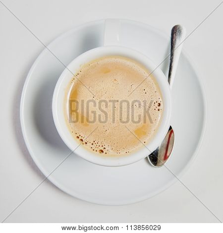 cup of fresh espresso on table,
