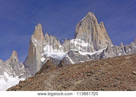 High Peaks Appearing Over The Ridge