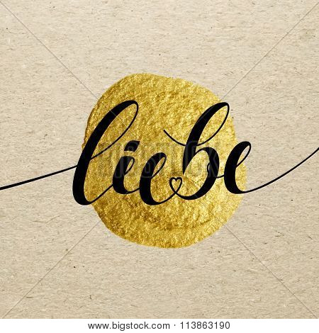 German Valentines day card. Liebe calligraphy lettering with gold paint stain on craft background. Hand drawn letters.