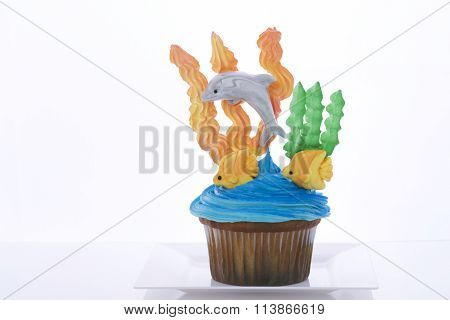 Aquatic Under the Sea cup cake on white plate