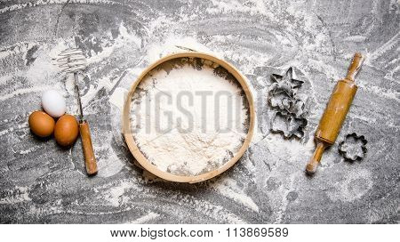 Preparation Of The Dough. Ingredients For The Dough - Flour In The Sieve, Eggs And Rolling Pin With