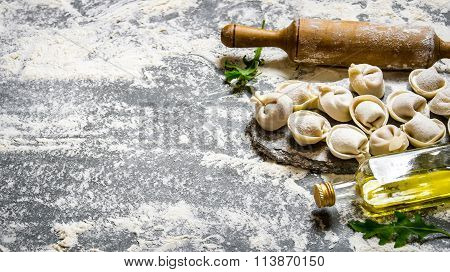 Homemade Ravioli With Olive Oil And With A Rolling Pin.