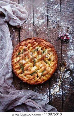 Apple pie on vintage wooden background texture. Top view. Homemade apple pie, apples on the wooden t