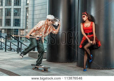Old Grandfather Rushes On A Skateboard.