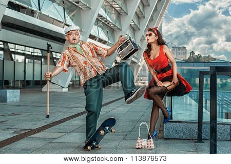 Old Grandfather Rides Skateboard Past The Girl.