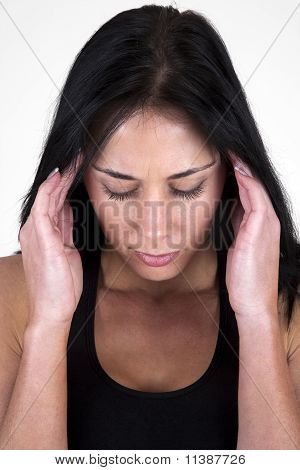 Woman holding her head in her hands, headache