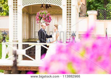 bride and groom in the gazebo