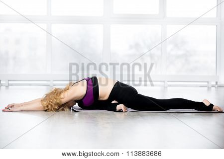 Senior Woman Doing Sleeping Swan Yoga Pose