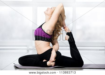 Senior Woman Doing One-legged King Pigeon Pose
