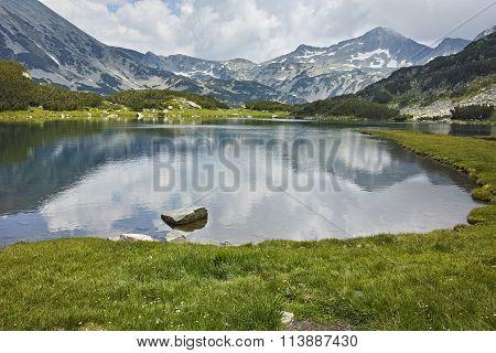 Amazing Landscape of  Banderishki Chukar peak and reflection in Muratovo lake, Pirin Mountain