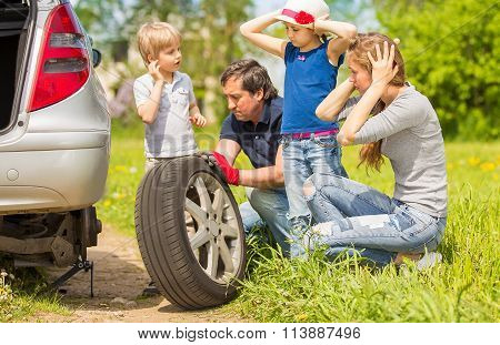 Friendly Family Changes The Tyre Of The Car