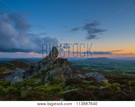 rock formation at sunset, Corndon hill from the Stiperstones