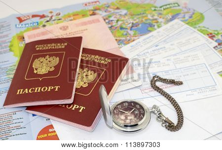 passports, ticket, watch and map