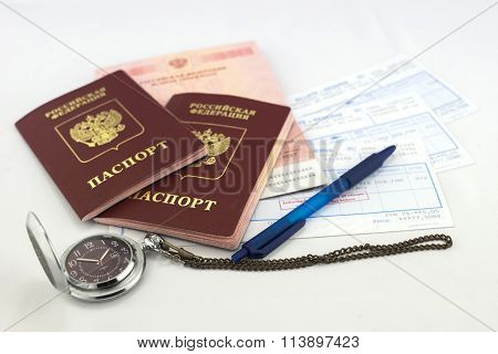 Passports, ticket, watch and pen