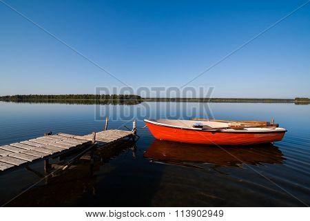 Idyllic Glassy Lake Landscape with Rowing Boat