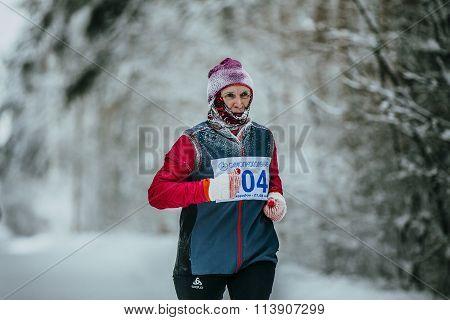 closeup male runner average years of running in winter woods