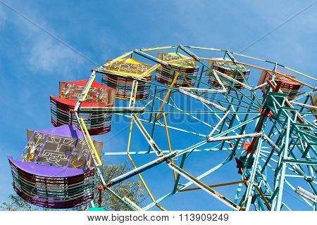 Ferris Wheel And Blue Sky Background