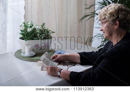 Widow Looking Over Memorabilia