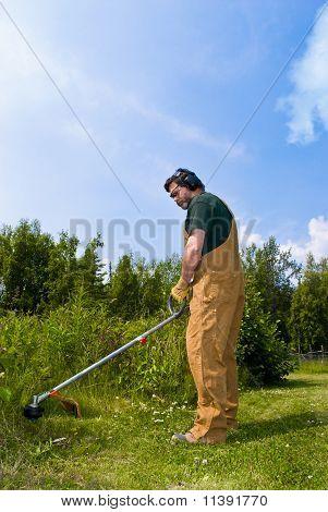 Man Operating String Trimmer