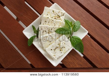Greek Feta Cheese On Wooden Table
