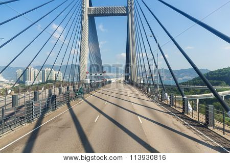 Passing though the Suspension bridge in Hong Kong