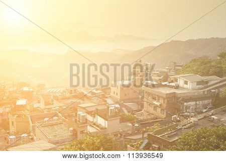 City sunset scenery with buildings on hill and harbor far away in Jiufen(Jioufen), Taiwan, Asia.