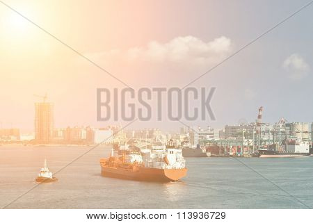 Cityscape of ocean with freighter on water of harbor in daytime in Kaohsiung, Taiwan.