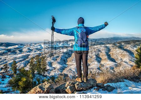 male hiker enjoying a view of Rocky Mountains foothills  - winter scenery at Horsetooth Mountain Open Space  near Fort Collins, Colorado