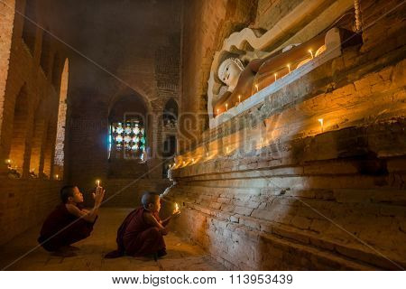 Unidentified Buddhism neophyte prays in Buddihist temple