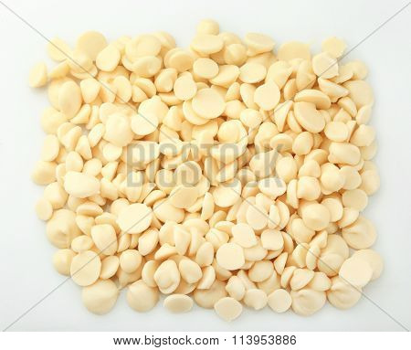 White chocolate morsels isolated on white