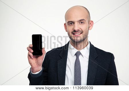 Handsome cheerful young businessman showing blank screen smartphone over white background