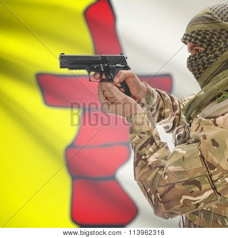Male In With Gun In Hand And Canadian Province Flag On Background - Nunavut