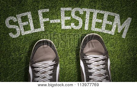 Top View of Sneakers on the grass with the text: Self-Esteem