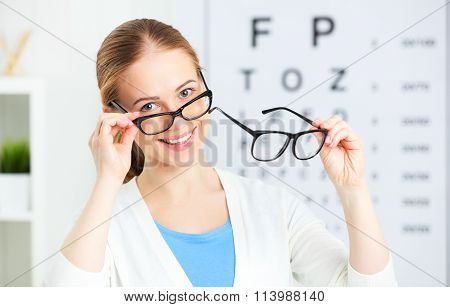Eyesight Check. Woman Choose Glasses At Doctor Ophthalmologist Optician