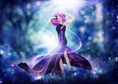 Beautiful Fantasy Fairy Woman, Fashion Art Beauty Portrait. Beautiful Girl in Fantasy Mystical and Magical Spring Garden. Model Woman wearing flowers wreath and Long satin dress making magic outdoor poster