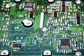 Computer Hard Disk Electronics Circuit Macro Photo. Hard disk repairing concept Data saving concept. Blur background with selective focus. poster