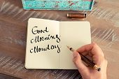 Retro effect and toned image of a woman hand writing a note with a fountain pen on a notebook. Motivational concept with handwritten text GOOD MORNING MONDAY poster