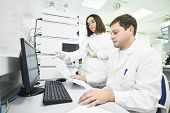 Researchers analyzing liquid chromatography data poster