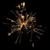 small firework sparkler at night like isolated at the black background poster