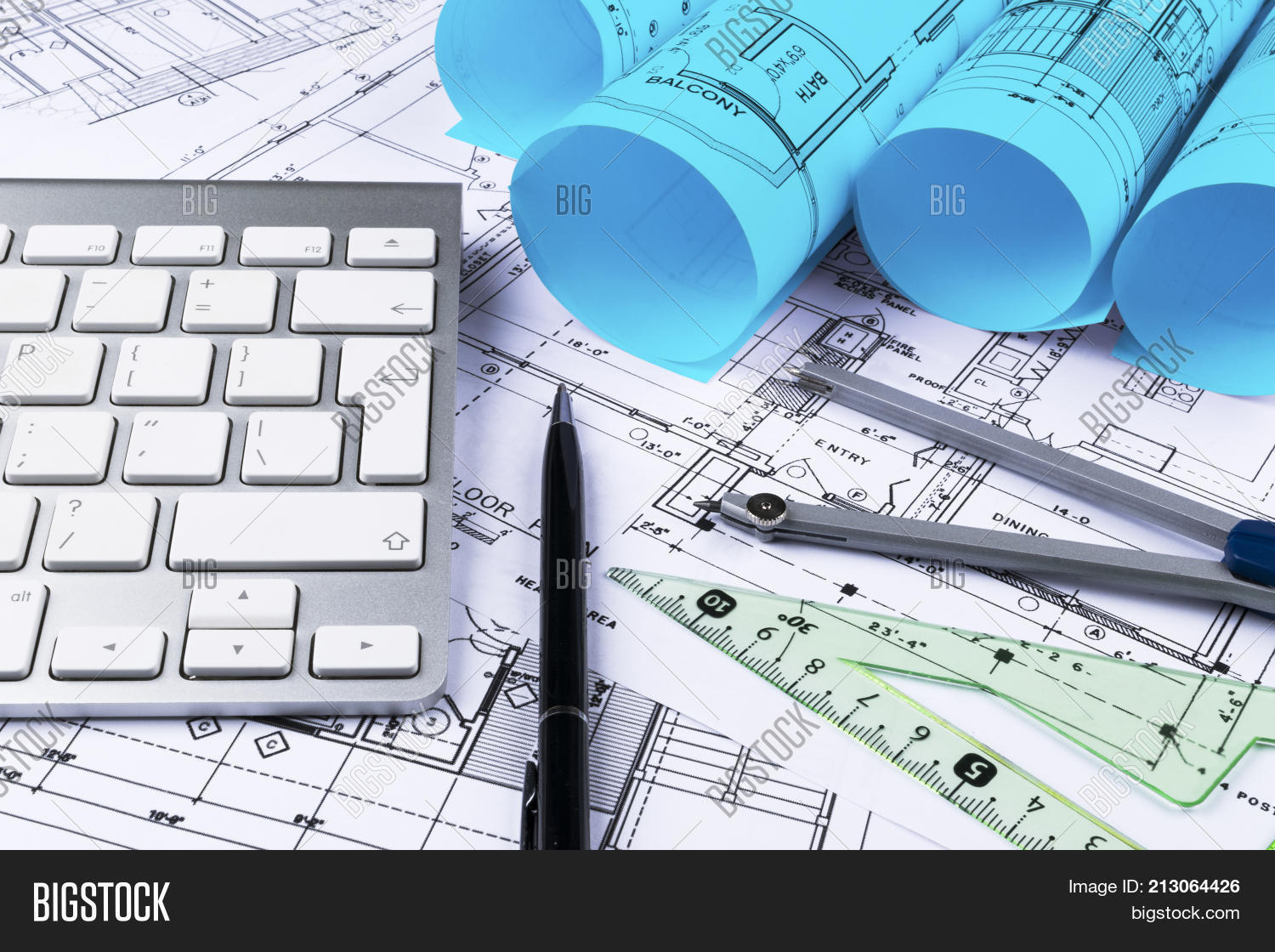 Architectural drawings image photo free trial bigstock architectural drawings of the modern house with computer keyboard architectural blueprints and blueprint rolls and malvernweather Images