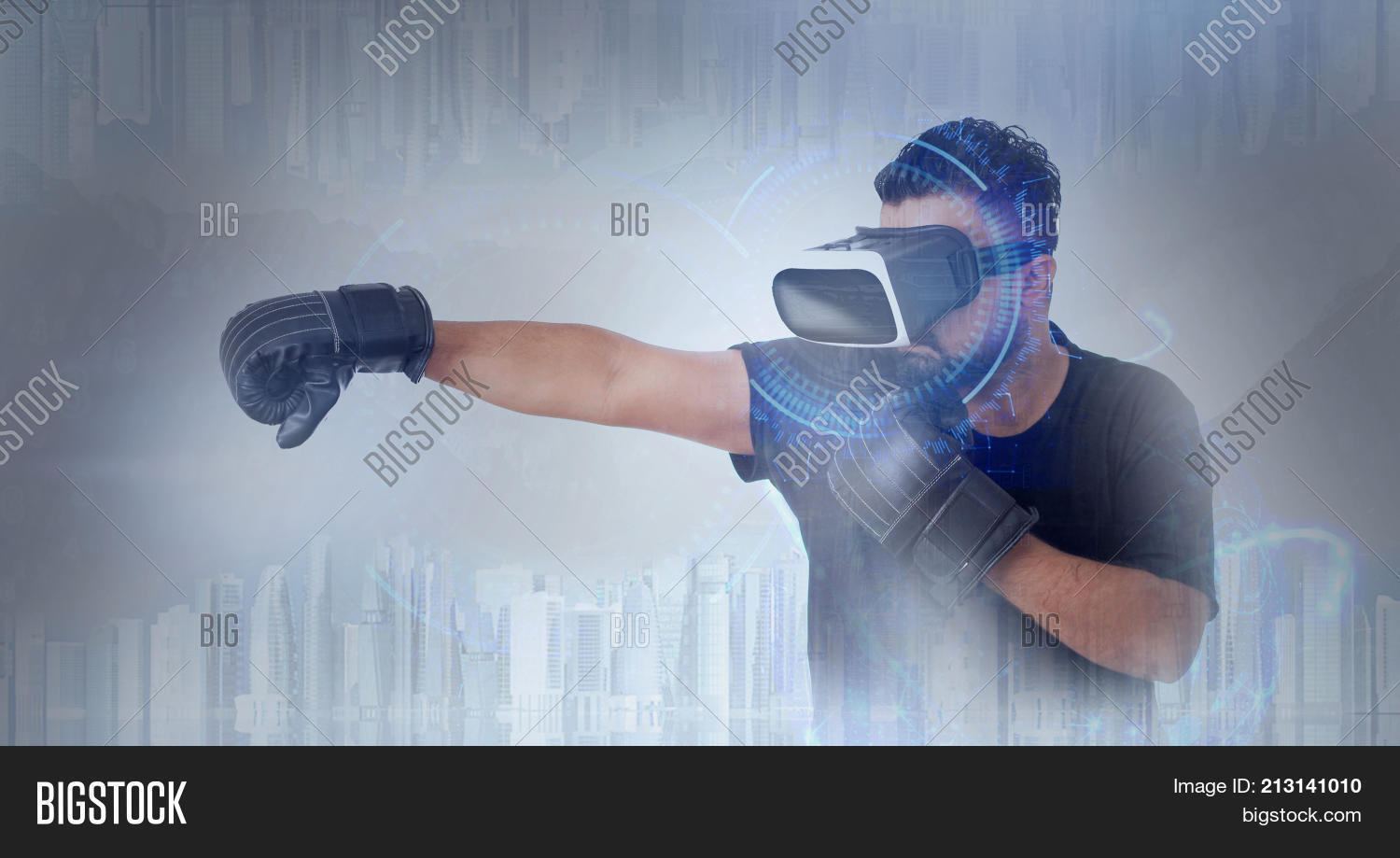 522d19c854b1 Young Guy in black t shirt looking through VR (Virtual Reality) glasses -  Boxing