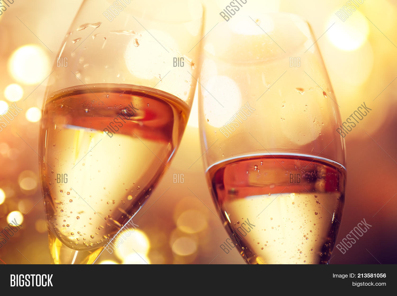 christmas and new year celebration with champagne new year holiday glowing gold background two