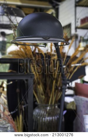 Vintage black metal lamp on the table stock photo
